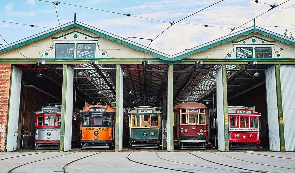 Five trams sitting at the entrance of the Bendigo Tramways Depot Shed
