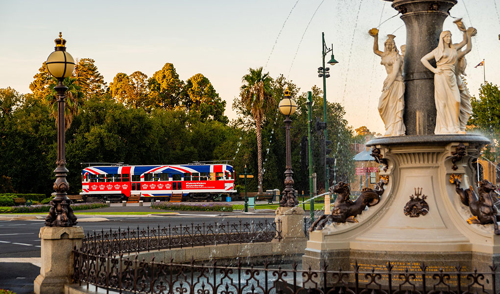 Royal Pop Up Tram at dusk with Alexandra Fountain in the foreground