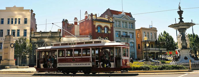 Bendigo Tramways Vintage Talking Tram Tour passing historic buildings on Pall Mall