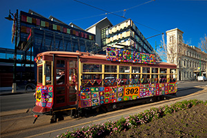 The Yarn Bomb Tram passing the Bendigo Bank Headquarters