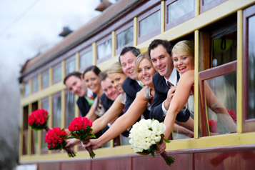 Wedding party hanging out windows of a Bendigo Tramways Tram