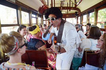 Elvis impersonator performing aboard a Bendigo Tramways Tram for Hens Party