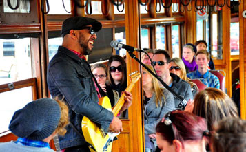 Musician performing aboard a sold out Bendigo Tramways Blues Tram