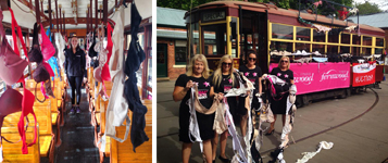 A tram covered in bras to raise awareness for Octobra