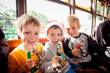 Children smiling aboard the Bendigo Tramways Santa Tram