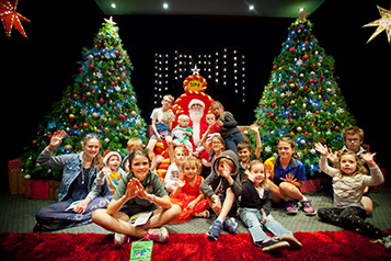 Children sitting with Santa as part of the Bendigo Tramways Santa Tram experience