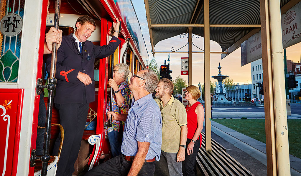 Tram Driver welcoming passengers aboard a tram in Bendigo at Alexandra Fountain