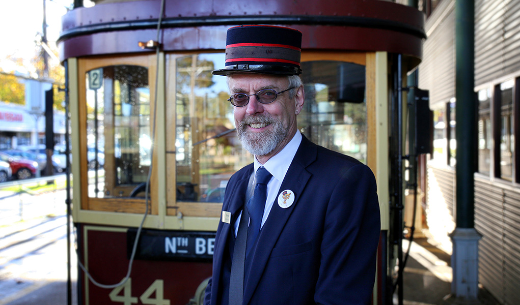 Volunteer Bendigo Tramways Conductor standing in front of Tram 44 at the Central Deborah Gold Mine