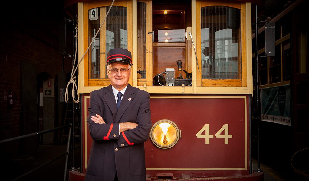 Tram Driver standing in front of a tram at the Bendigo Tramways Depot